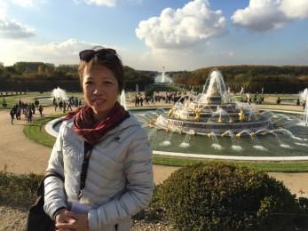 Celia So in Versailles garden
